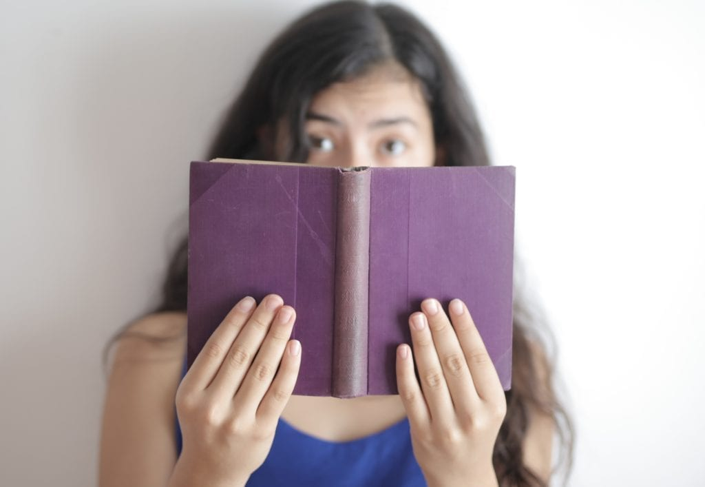 autistic woman with a book